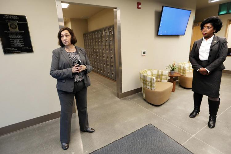 Napa County Chief Probation Officer Mary Butler, left, and Napa County Director of Department of Corrections, Dina Jose, right, prepare to lead a tour of the county's new jail reentry facility in south Napa. JL Sousa, Register