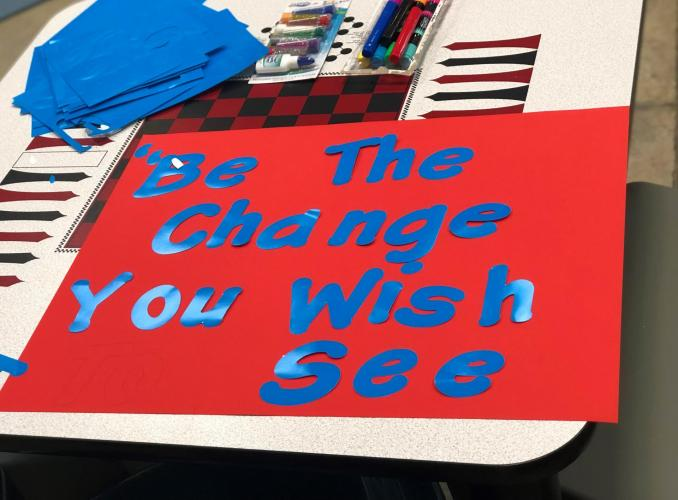 "Artwork by youth stating ""be the change you wish to see"""