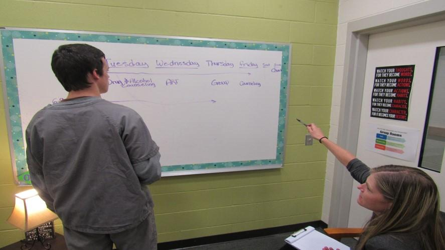 Youth at whiteboard in classroom